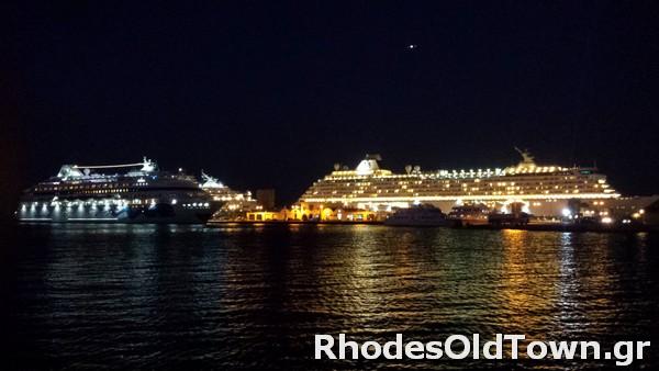 AIDAcara and Crystal Serenity at Rhodes Cruise Ships Port nighttime