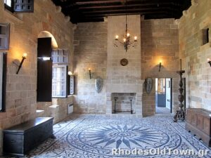 Living room with fireplace, mosaic floor and medieval decoration
